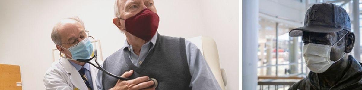 Doctor Kim Eagle wearing mask using stethoscope on older male patient wearing mask