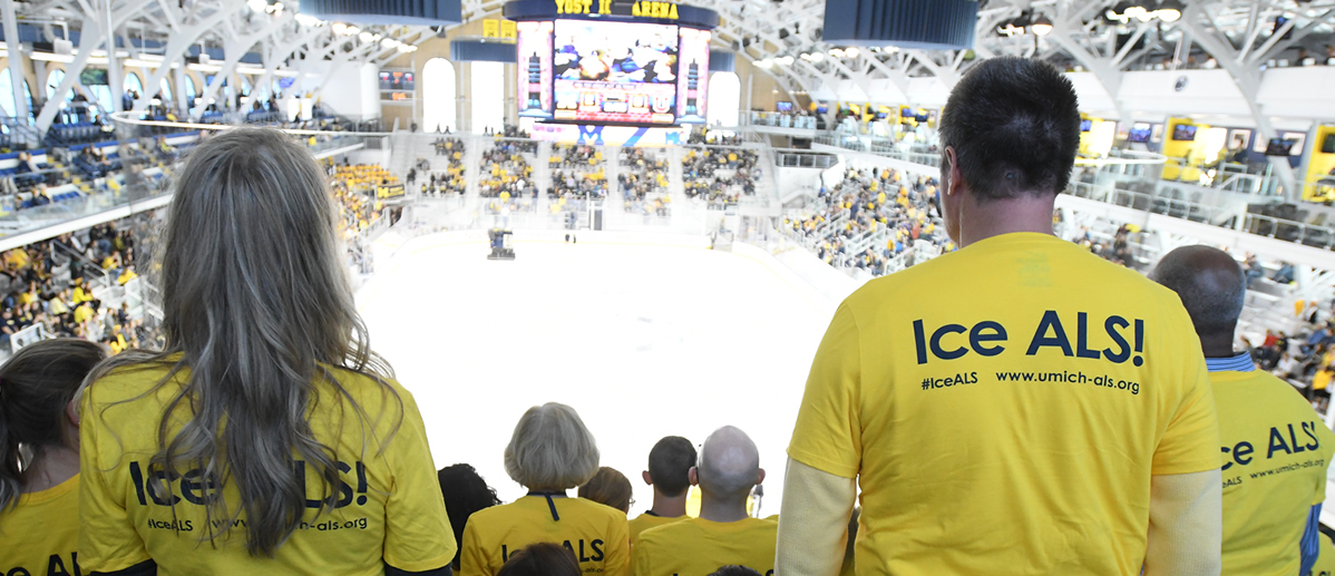 Hockey fans watching game at U-M Yost Arena wearing Ice ALS t-shirts