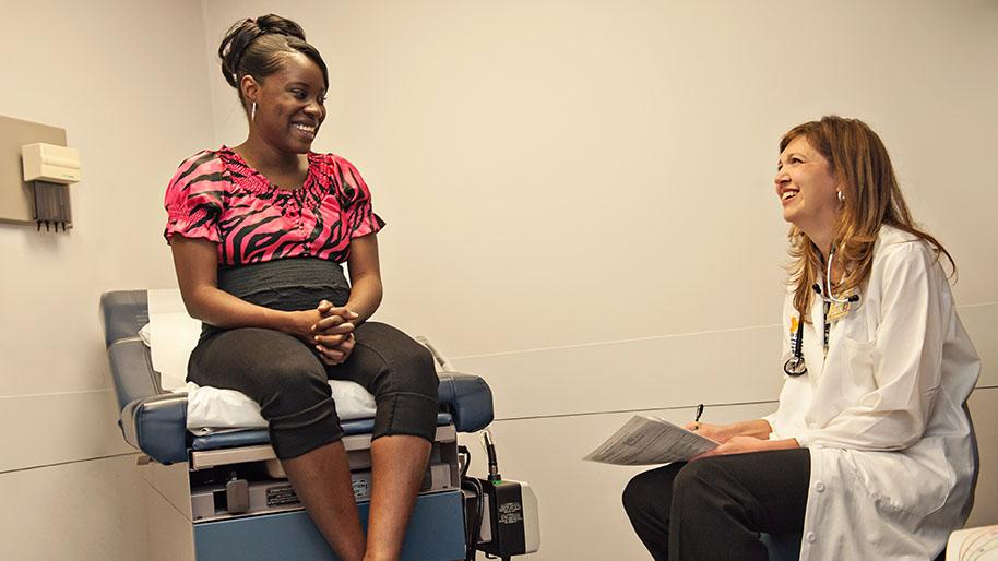 Dr. Melinda Davis examining a patient