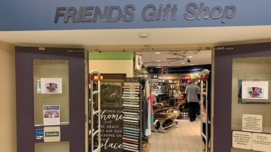 Friends Gift Shop storefront with open doors and gift merchandise inside