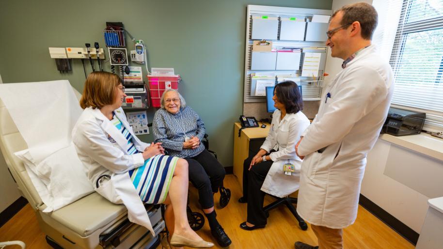 geriatric patient with medical professionals.
