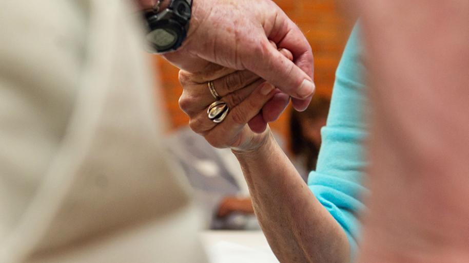 Eldery hands touching