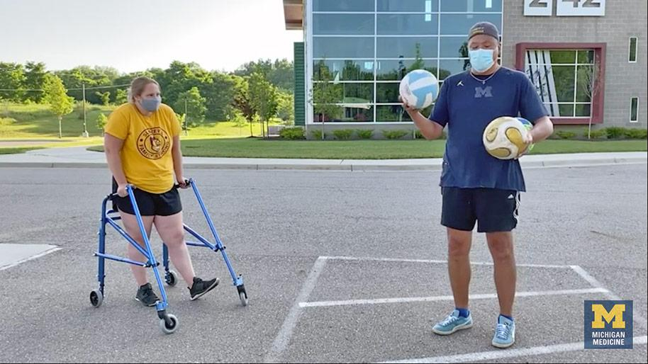 Two people playing accessible soccer.