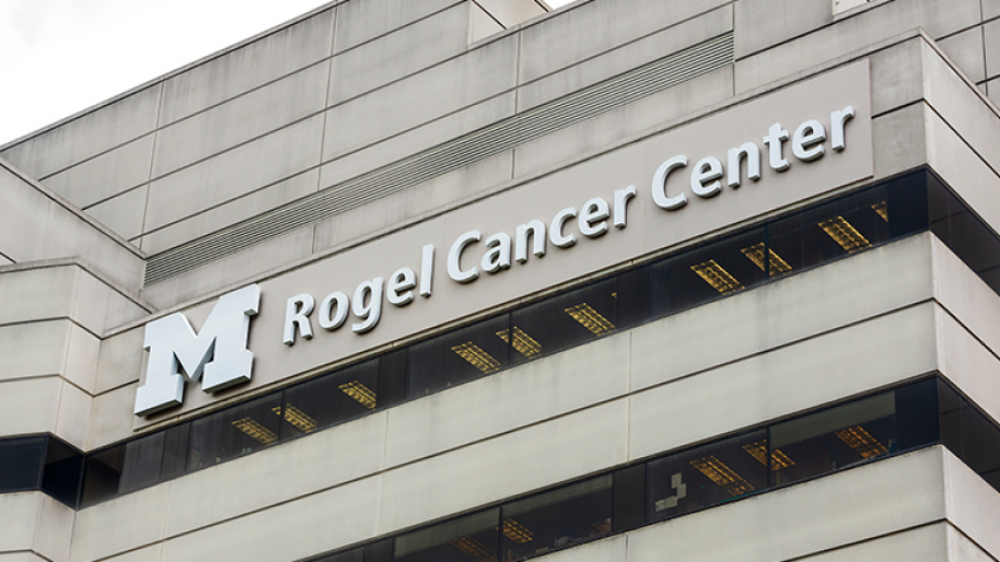 The Rogel Cancer Center building with its name displayed near the roof line.