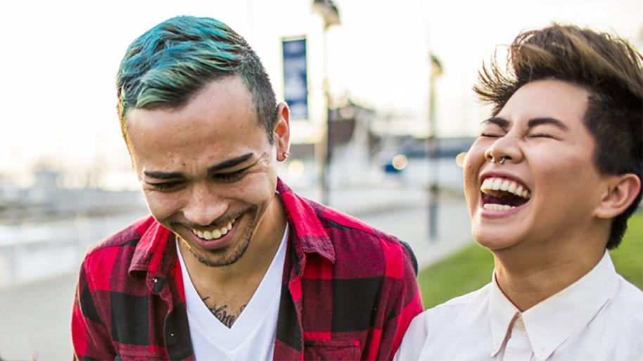 Two young people laughing