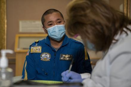 Michigan Medicine nurse Johnnie Peoples receives his COVID-19 vaccination.