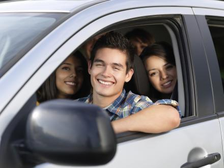 Teenagers Driving Cars