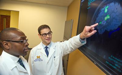 Doctors from the University of Michigan Brain Tumor Program discuss a brain scan