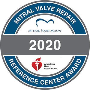 """MItral Valve Repair Reference Center Award 2020 from Mitral Foundation and American Heart Association: blue """"O"""" shape with white center with Mitral Foundation and AHA logos"""