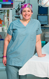 Nurse in scrubs with colorful hair cap