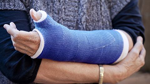 Person in blue arm cast