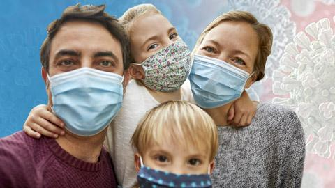 Man, woman and two kids wearing blue masks