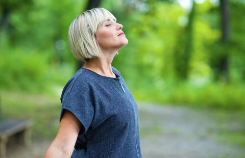 Woman outside deep breathing