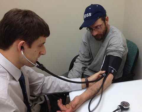 Student takes a patient's blood pressure