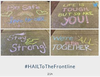 Message written on a sidewalk in chalk