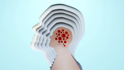 Beige head with multiple outlines with red coronavirus cells within