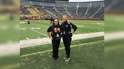2 females on the field at Michigan Stadium