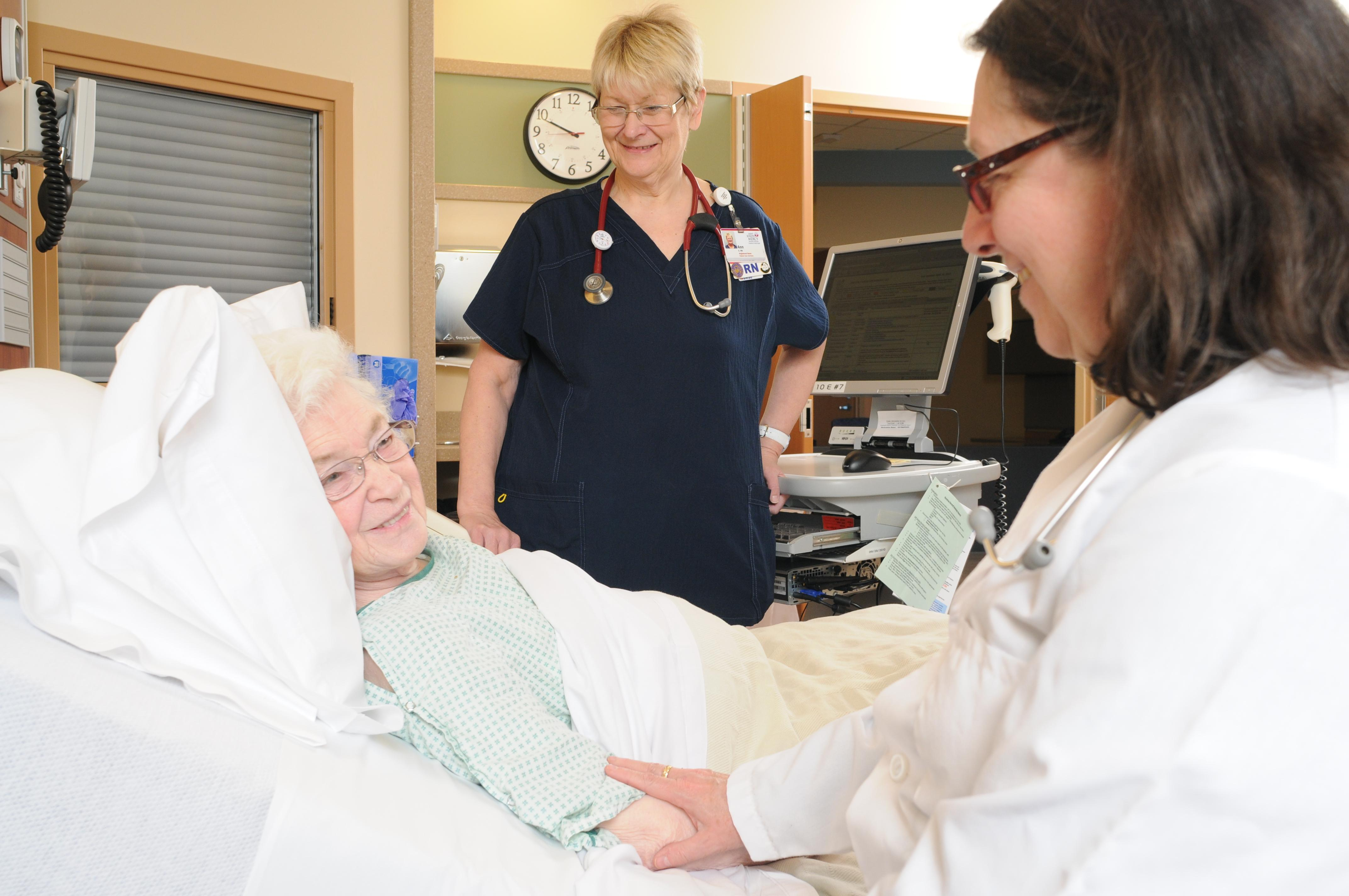 Photo of a doctor with patient in the Acute Elderly Care unit