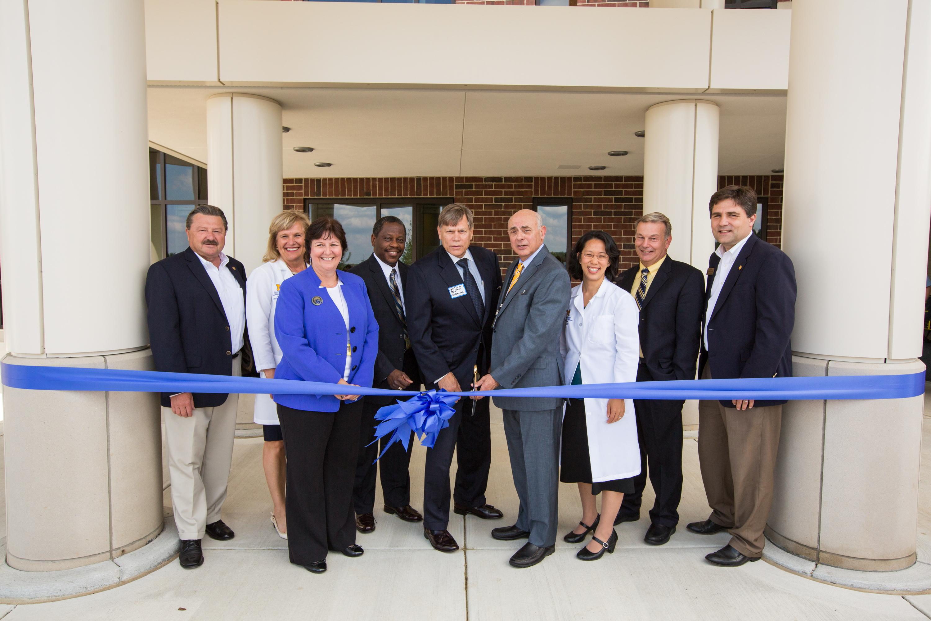 U-M leaders and elected officials celebrate opening of Northville Health Center.