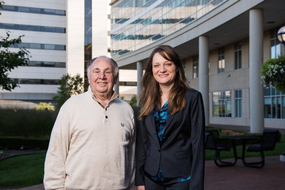 Laurence Baker and Monika Leja stand outside of the University of Michigan Frankel Cardiovascular Center