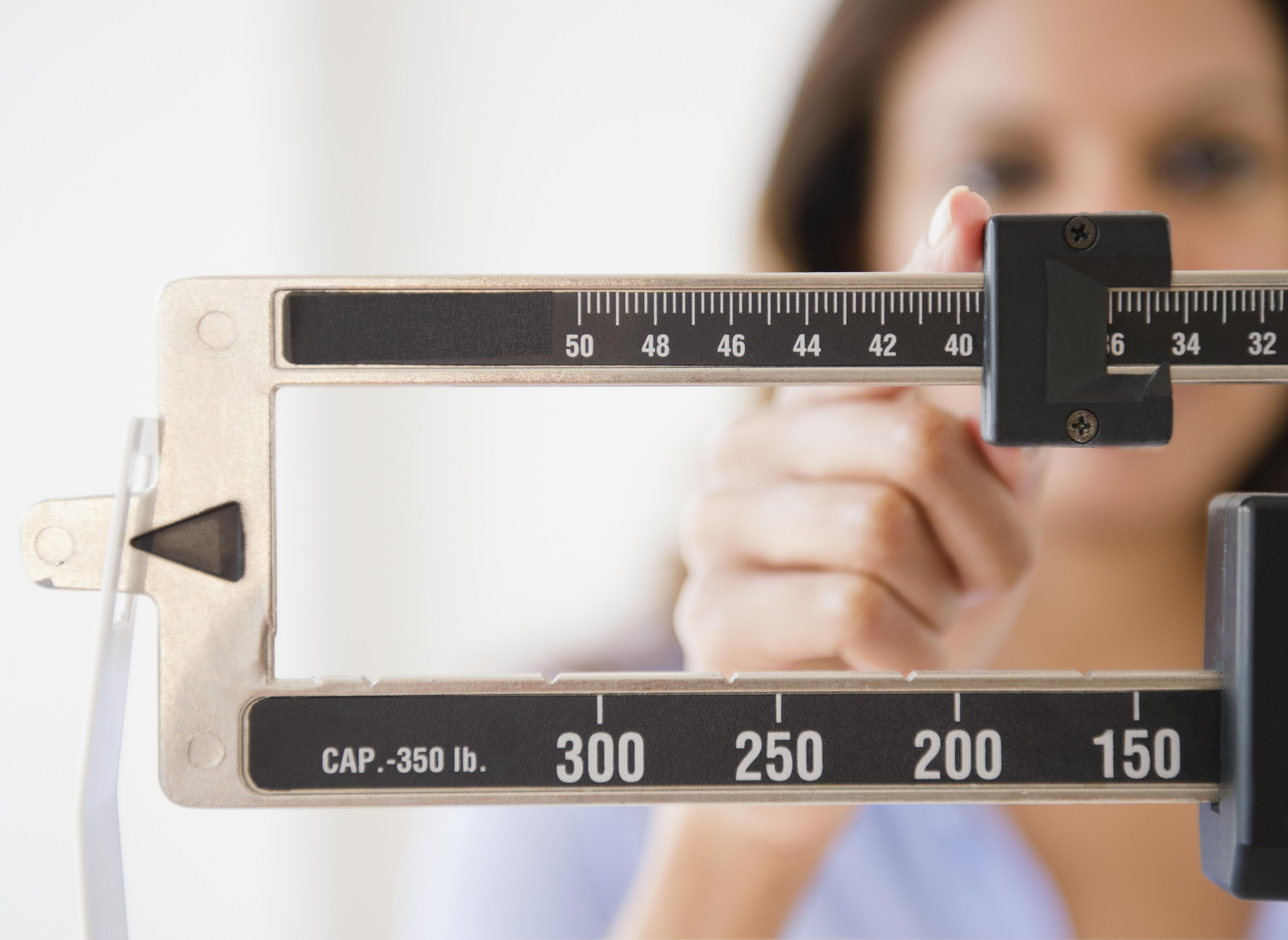 Woman with doctor's scale