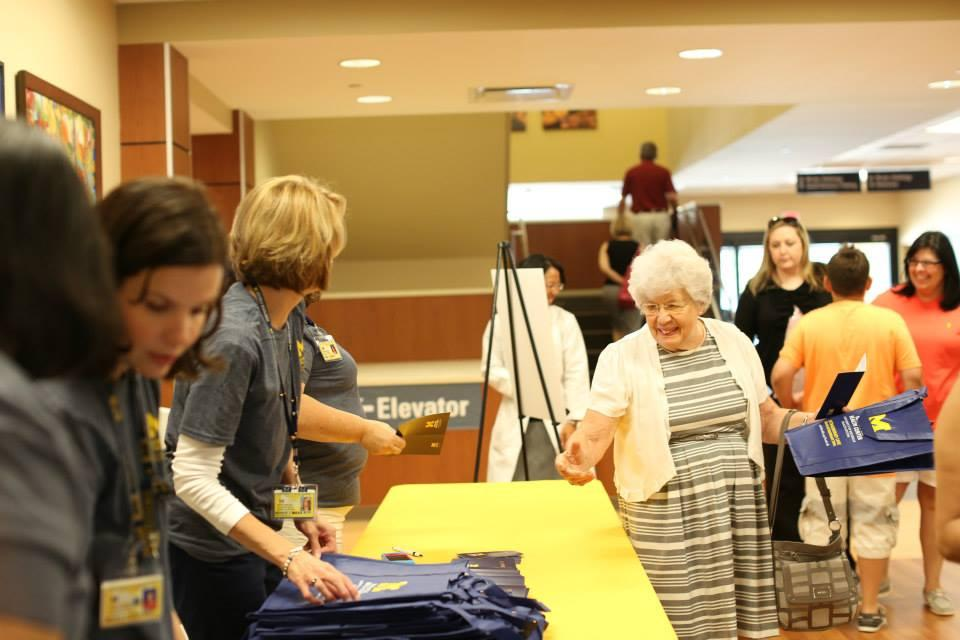 Greeters provide a passport to world-class care during the Northville Health Center community open house.