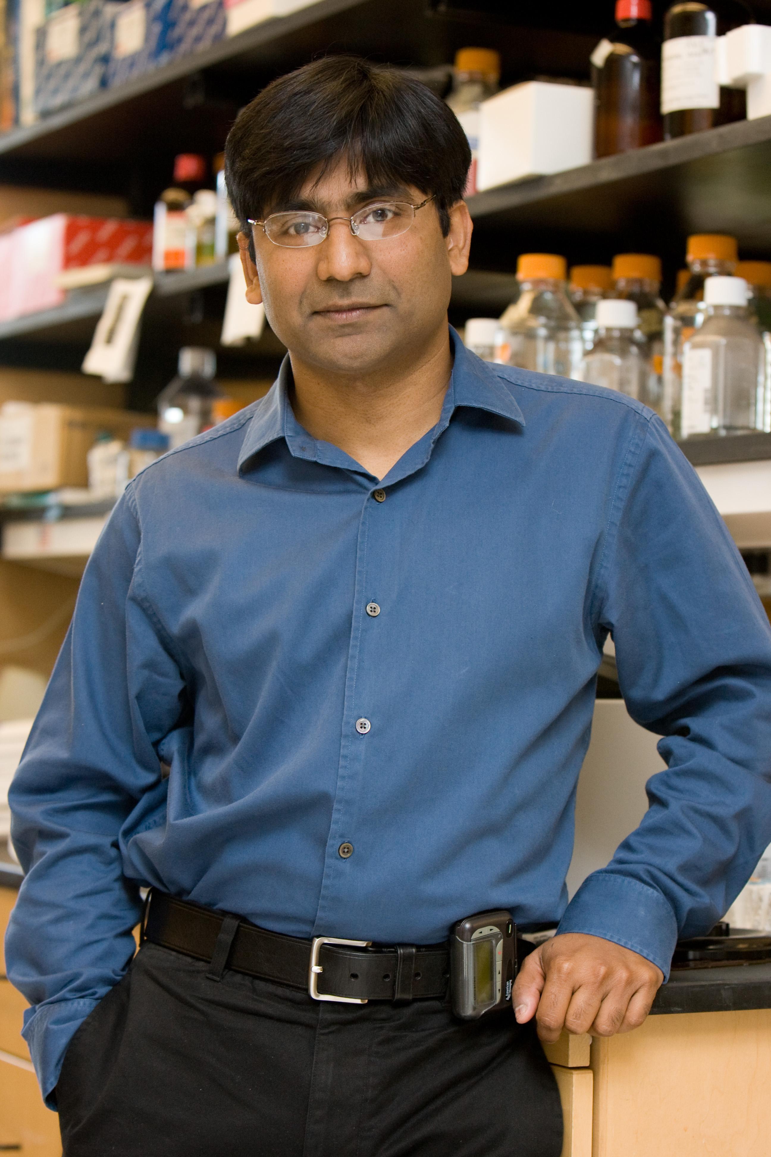 Dr. Pavan Reddy stands in his lab