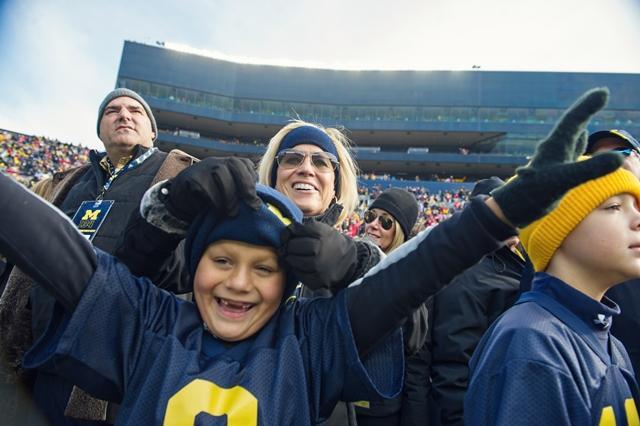 Colon cancer survivor Tiffany Hecklinski with her son at a U-M football game