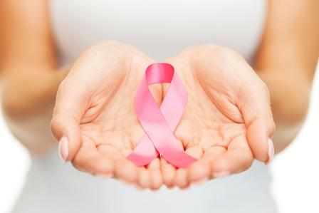 cupped hands holding a pink ribbon