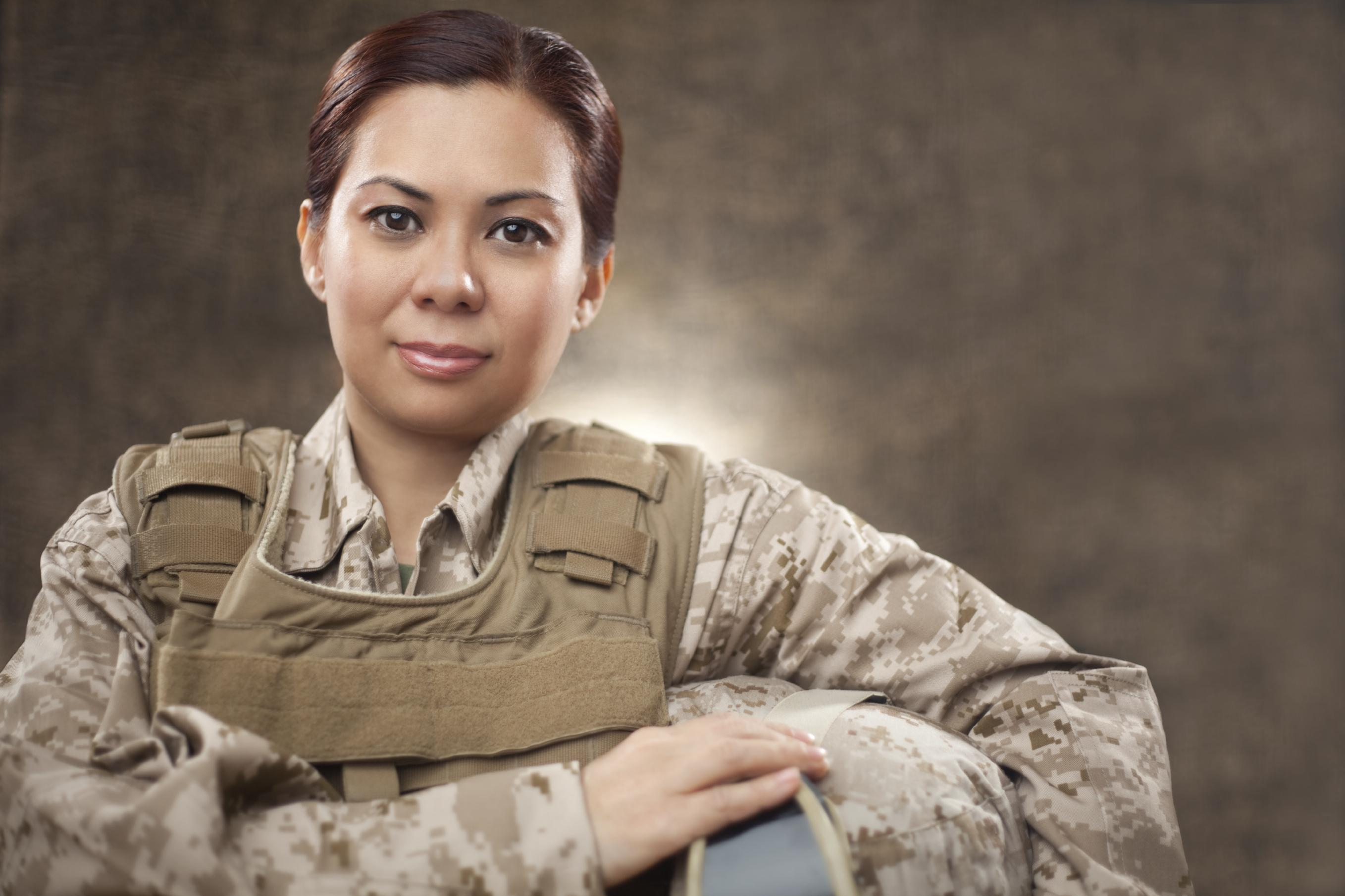 Woman veteran wearing camoflage