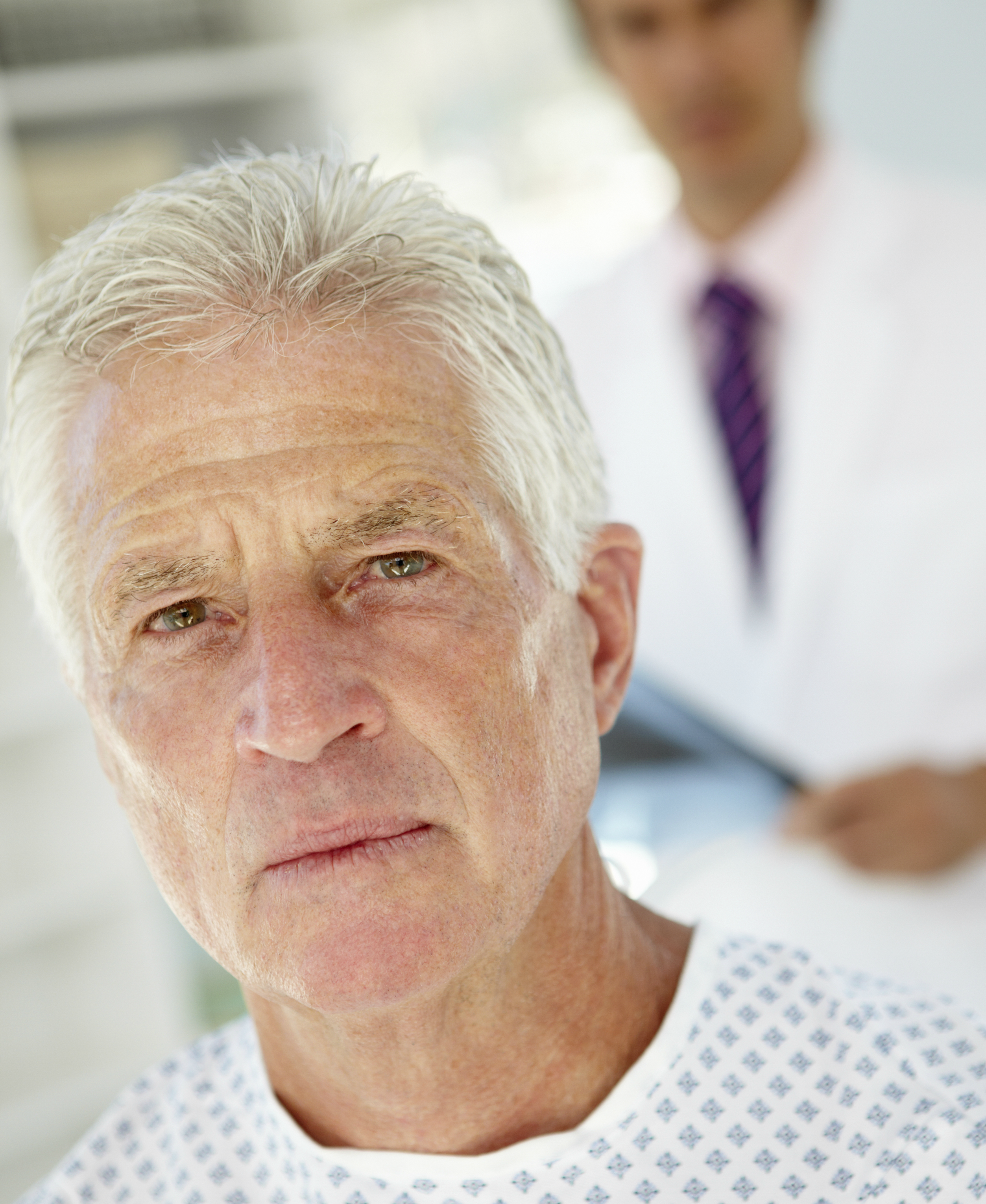 Older male patient with physician