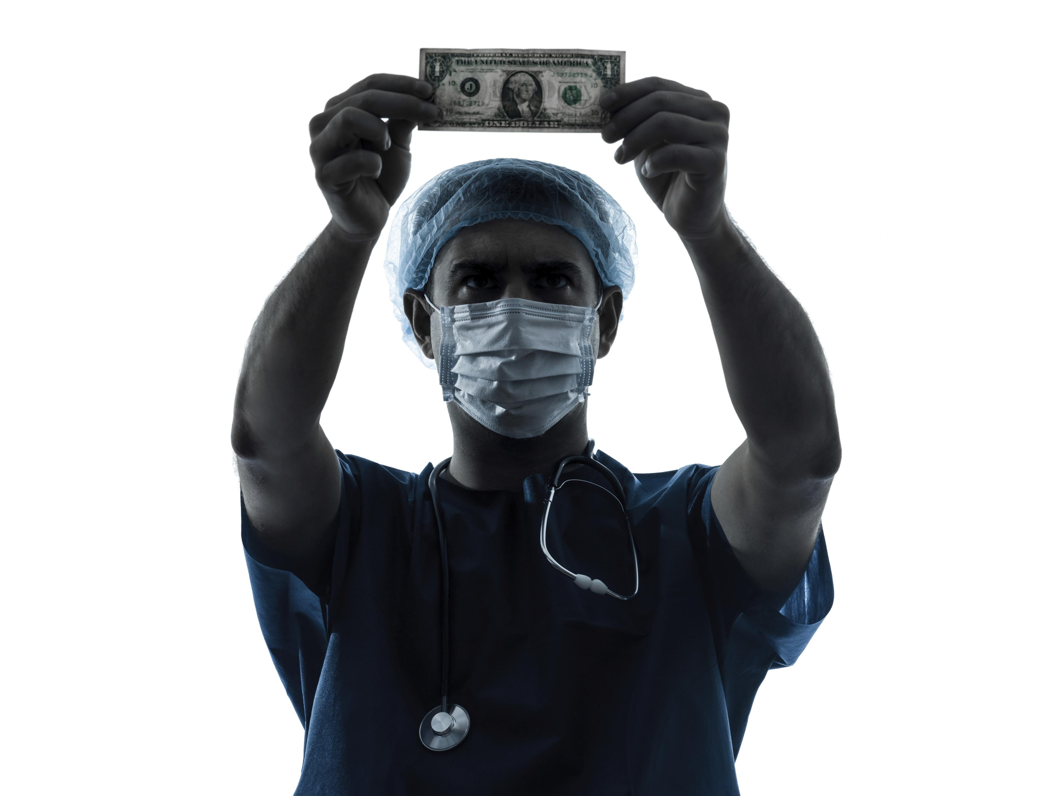 Surgeon with dollar bill
